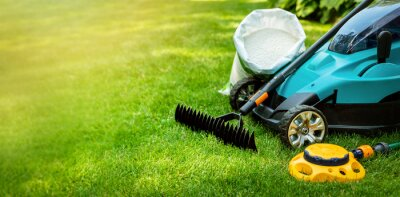 Image garden lawn care tools and equipment for perfect green grass. banner copy space