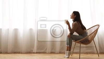 Image Girl Sitting in Armchair And Enjoying Coffee