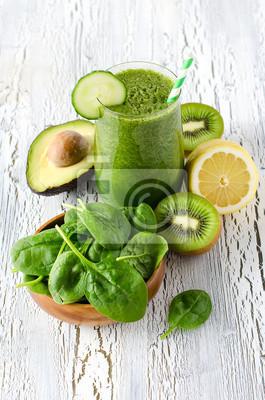 Green fresh healthy detox smoothie with spinach, avocado, kiwi.