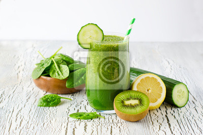 Green fresh healthy detox smoothie with spinach, cucmber, kiwi.