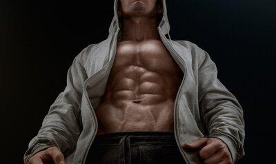 Image Gros plan sur abdos parfaits. Forte bodybuilder avec six pack