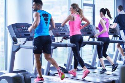 Image Group of people running on treadmills