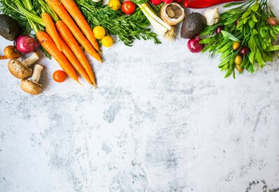 Healthy organic bio vegetables frame with carrots, greens, onion, avocads, tomatoes, mushrooms, fresh green bio harvest, top view on concrete background