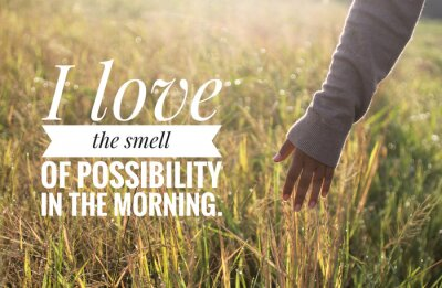 Image Inspirational motivational quote - I love the smell of possibility in the morning. With warm morning light over the field & young woman hand touch the leaves of paddy in field background.
