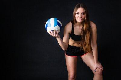 Image Jeune fille tenant le volleyball sur fond noir