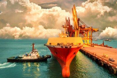 Image La logistique et le transport de la cargaison internationale de récipient de cargaison avec le pont de grue de ports dans le ciel de port et de soirée pour l'arrière-plan logistique d'exportation d'im