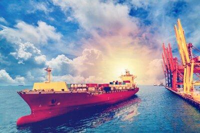 Image La logistique et le transport de la cargaison internationale de récipient de cargaison avec le pont de grue de ports dans le port pour l'arrière-plan logistique d'exportation d'importation et l'indust