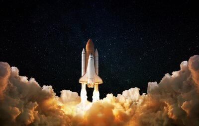 Image Launch of Space,Spaceship takes off into the night sky.Rocket starts into space concept.Elements of this image furnished by NASA