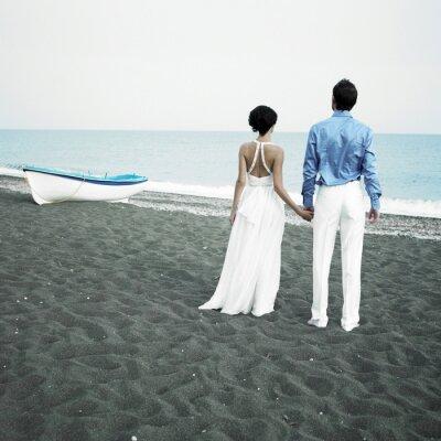 Image Les nouveaux mariés à la mer