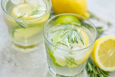 Lime, lemon , rosemary lemonade with ice cubes, refreshing summer drink