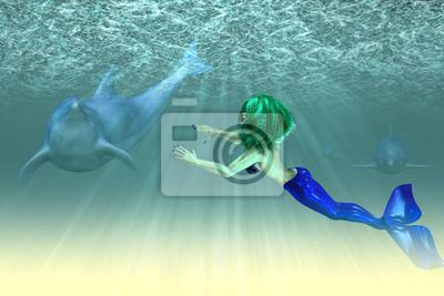 Mermaid fille avec les dauphins