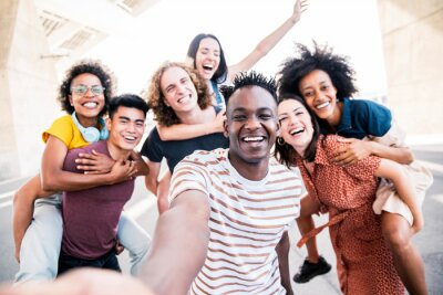 Image Multicultural happy friends having fun taking group selfie portrait on city street - Young diverse people celebrating laughing together outdoors - Happy lifestyle concept
