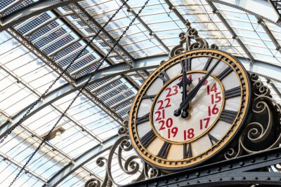 Image Old-fashioned style clock at Kings Cross train station in London