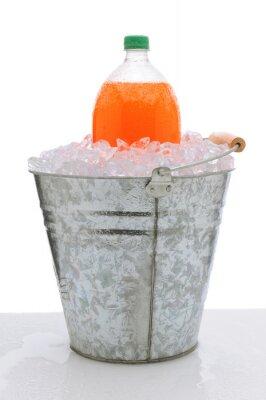 Orange Soda Bottle in Bucket of Ice