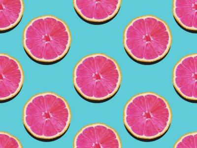 Image Pamplemousse en lay plat Fruité motif de pamplemousse à chair rose sur fond turquoise Moderne plat lay photo motif en style pop art
