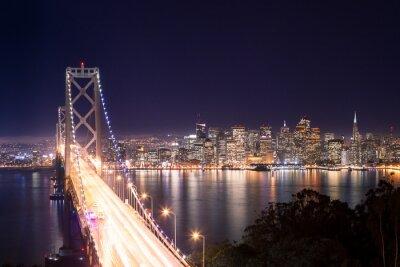 Image Panorama di San Francisco Bay Bridge e di notte