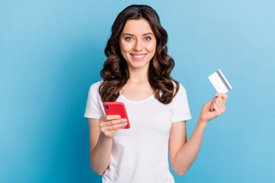 Image Photo of pretty cute young lady dressed white outfit holding modern gadget bank card isolated blue color background