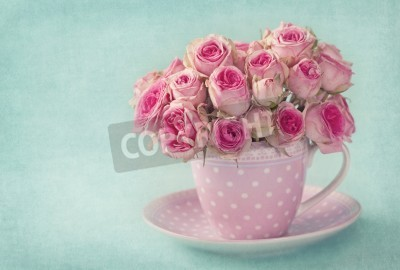 Image Pink roses in a cup on blue background