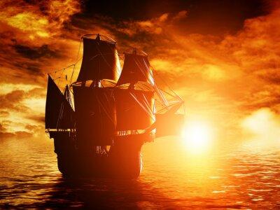 Image Pirate antique navire naviguant sur l'océan au coucher du soleil
