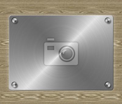 plaque de métal sur fond de bois
