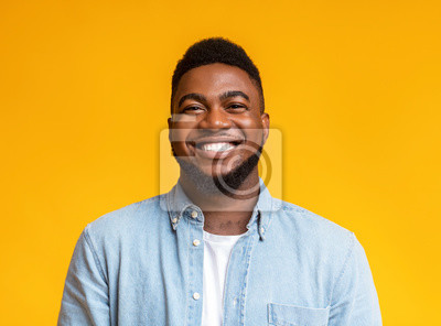 Image Portrait of cheerful bearded black man over yellow background