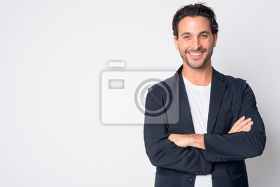 Image Portrait of happy handsome Hispanic businessman smiling with arms crossed