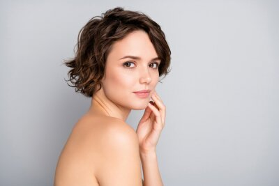 Image Portrait of pretty charming attractive girl look in mirror touch hands face enjoy her soft ideal perfect skin after anti aging rejuvenation procedure isolated over gray color background