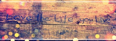 Image Positive inspiring quote written carved  in wood Love the life you live. Best motivational quotes, inspirational quotes and sayings about life. Motivation, and inspiration image quote
