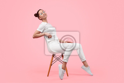 Image Relaxed teen girl sitting on chair
