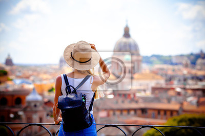 Image Rome Europe Italia travel summer tourism holiday vacation background -young smiling girl with mobile phone camera and map in hand standing on the hill looking on the cathedral Vatican