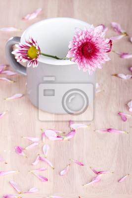 rose flowersin une tasse