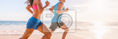 Image Run fit people running on beach with healthy toned legs body, Hamstring muscles, knee joint health active lifestyle panoramic banner background.
