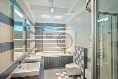 Salle de bains moderne dans les tons bleus et gris avec de la ...