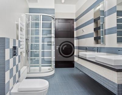 Salle de bains moderne dans les tons bleus et gris avec une cabine ...