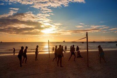 Image Silhouette des gens qui jouent au volley-ball