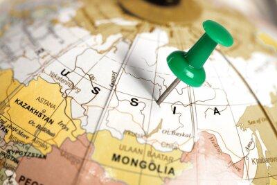 Image Situation Russie. Broches vert sur la carte.