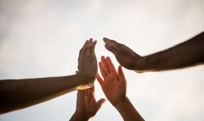 Image Soft focus of people giving fist bump showing unity and teamwork. Friendship happiness leisure partnership team concept.