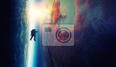 Image Spaceman and planet, human in space concept