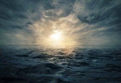 Image Sunset on stormy sea