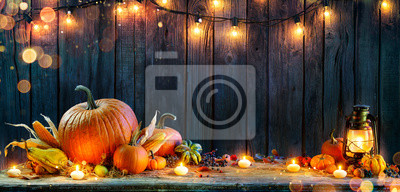 Image Thanksgiving - Pumpkins On Rustic Table With Candles And String Lights