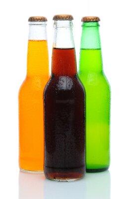 Three Assorted Soda Bottles on White