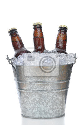 Three Brown Beer Bottles in Ice Bucket