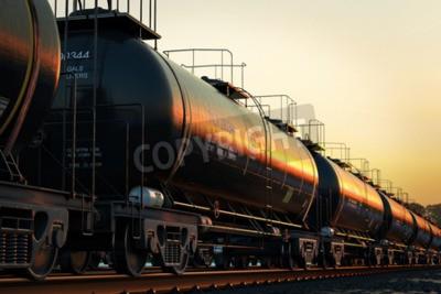 Image Transport des wagons-citernes avec de l'huile au coucher du soleil.