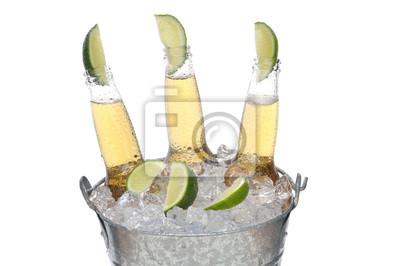 Trois bouteilles de bière avec Limes