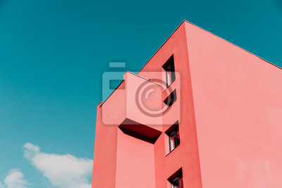 Image View from below on a pink modern house and sky. Vintage pastel colors, minimalist concept.