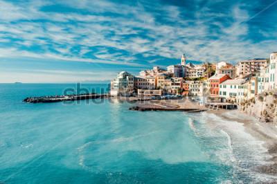 Image View of Bogliasco. Bogliasco is a ancient fishing village in Italy, Genoa, Liguria. Mediterranean Sea, sandy beach and architecture of Bogliasco town. Cloudy blue sky sunny day idyllic scenery, winter