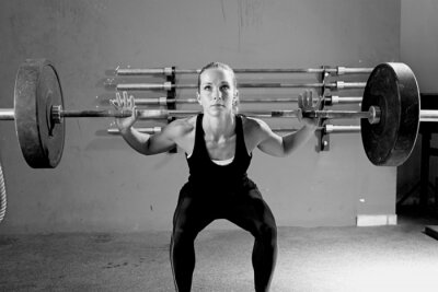 Image woman on a weightlifting session - crossfit workout.
