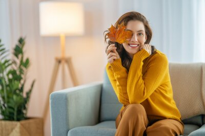 Image woman resting on sofa at home