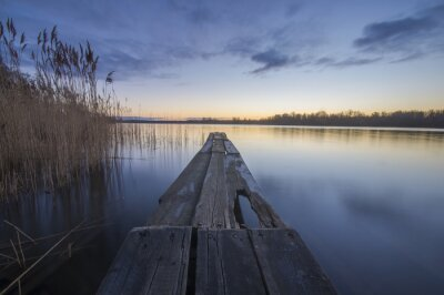 Image wooden bridge over a river in the morning