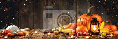 Image Wooden Table With Lantern And Candles Decorated With Pumpkins, Corncobs, Apples And Gourds With Wooden Background - Thanksgiving / Harvest Concept